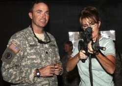 Sarah Palin with Alaska National Guard, Kuwait, 2007.  For this trip the governor had to apply for a passport.  Was it her first trip overseas? Photo: Politico.com.