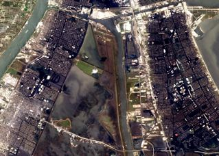 MR-GO navigation canal appears at center (vertical); Lower 9th Ward and St. Bernard Parish at left. Detail of NASA photo.